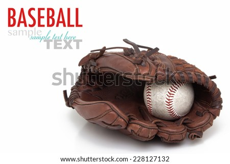 Close up of a old baseball glove and ball with sample text. Shot in studio and isolated on a white background. Macro with shallow dof. - stock photo