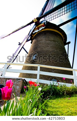 Close-up of a old fashioned windmill in the Dutch countryside - stock photo
