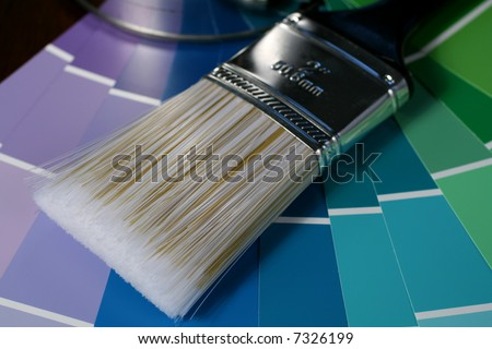 Close-up of a Paint Brush and Color Swatches. - stock photo