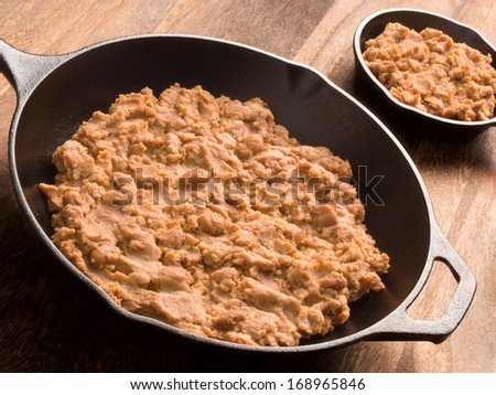 close up of a pan of refried beans - stock photo