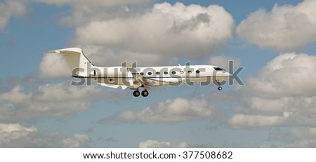 Close up of a passenger jet flying in a cloudy sky  - stock photo