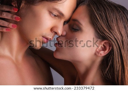 Close-up of a passionate couple on a white background - stock photo