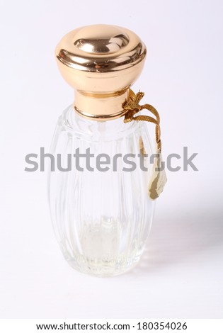Close up of a perfume bottle isolated on white background - stock photo