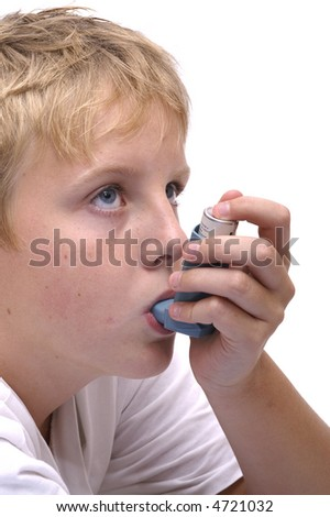 Close-up of a person inhaling medicine.