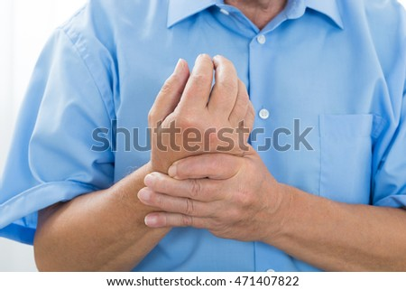 Close-up Of A Person Suffering From Wrist Pain