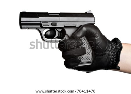 Close up of a persons hand wrapped in a leather glove gripping and aiming a semiautomatic handgun isolated over a white background. - stock photo