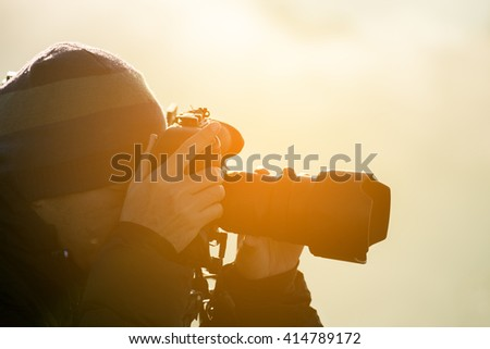 Close up of a photographer on the mountain.
