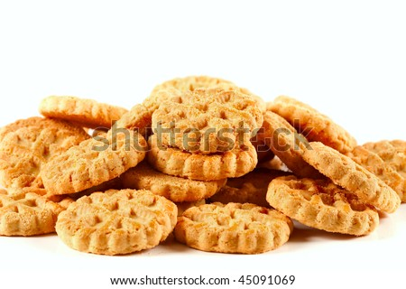 Close up of a pile of biscuits isolated on white