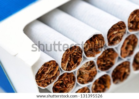 Close up of a pile of cigarettes in pack - stock photo