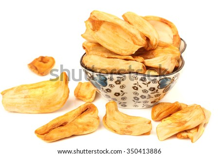 Close up of a pile of dried jackfruit chips isolated on white background - stock photo