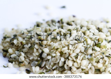 close up of a pile of hemp seeds on a white background - stock photo