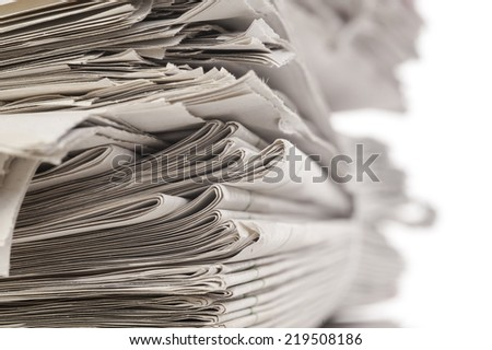 Close up of a pile of newspaper - stock photo