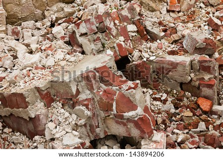 Close-up of a pile of old broken red bricks - stock photo