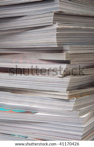 Close-up of a pile of old thick magazines.