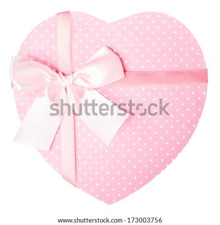 Close up of a pink, polka dot heart-shaped gift box - stock photo