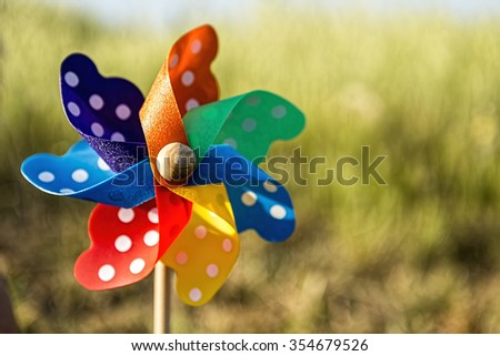 Close up of a Pinwheel on the grass (soft focus).  - stock photo