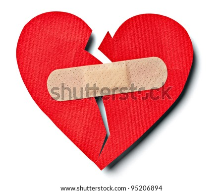 close up of  a plaster and  paper broken heart on white background with clipping path - stock photo