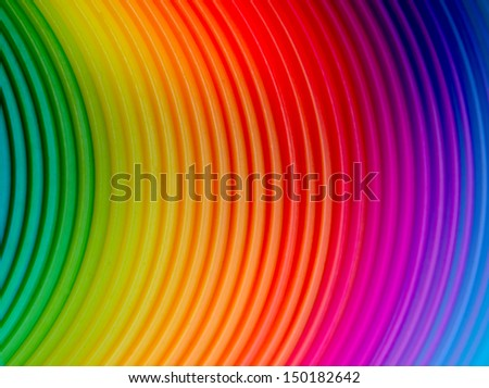 close up of a plastic rainbow spring