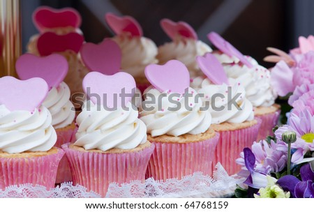 Close-up of a plate of delicious colorful cupcakes on a white plate - stock photo