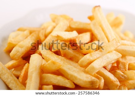 Close-up of a plate of french fries  - stock photo