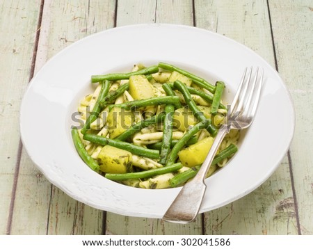 close up of a plate of rustic italian pasta genovese