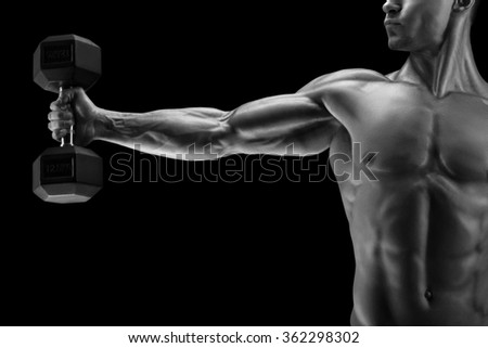 Close-up of a power fitness man's hand with dumbbell. Strong bodybuilder with six pack, perfect abs, shoulders, biceps, triceps and chest, deltoid muscle. Black and white photo. - stock photo