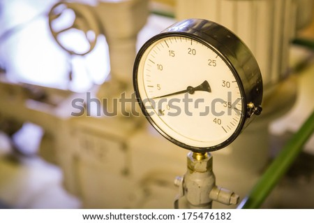 Close-up of a pressure gauge instrument - stock photo