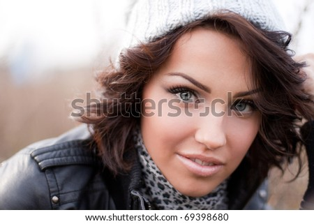Close up of a pretty brunette in a grey hat - stock photo