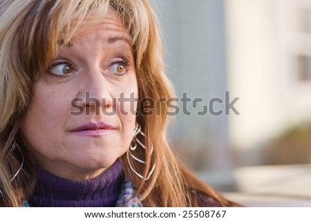 Close up of a pretty middle aged woman looking to the right. - stock photo