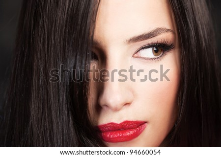 Close up of a pretty woman's face - stock photo