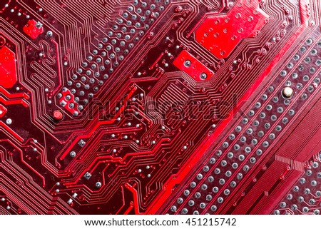 Close up of a printed red computer circuit board - stock photo