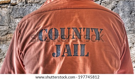 close up of a prisoner shirt in hdr tone - stock photo