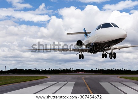 Close up of a private jet landing