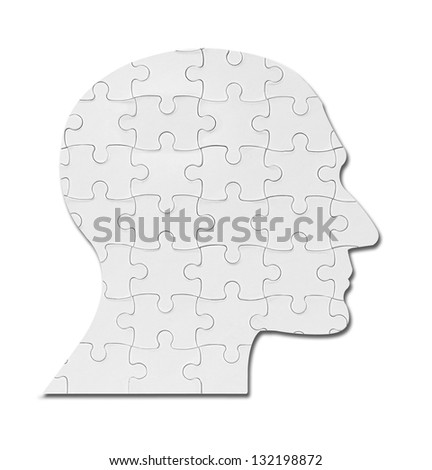 close up of a puzzle game parts on a head silhouette - stock photo