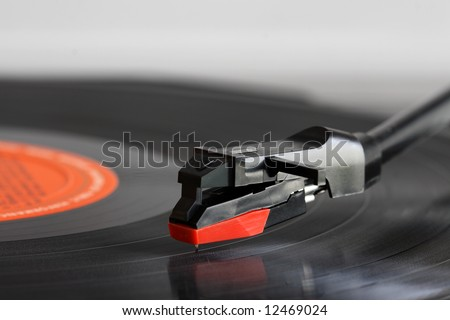 Close up of a record players needle. - stock photo
