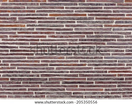 Close up of a red brick wall with white stripes, textures and copy space - stock photo