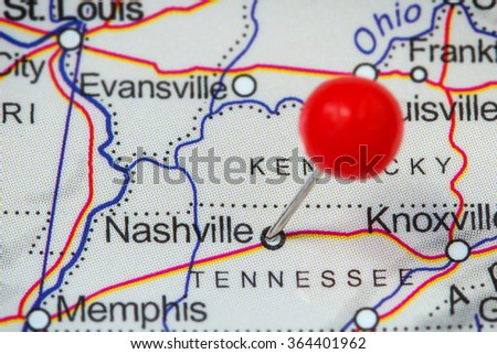 Close-up of a red pushpin in a map of Nashville, USA. - stock photo