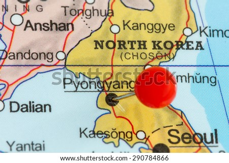 Close-up of a red pushpin on a map of Pyongyang, North Korea