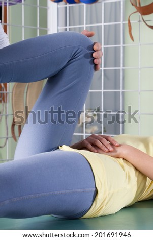 Close-up of a rehabilitation of twisted knee - stock photo