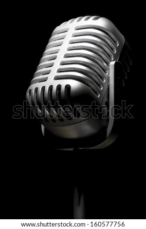 Close up of a retro mic in the spotlight - stock photo