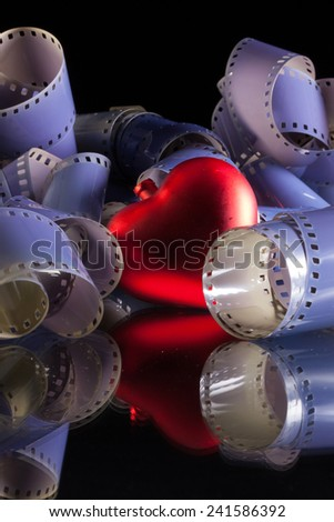 Close-up of a roll 35 mm photographic films and love symbol - stock photo