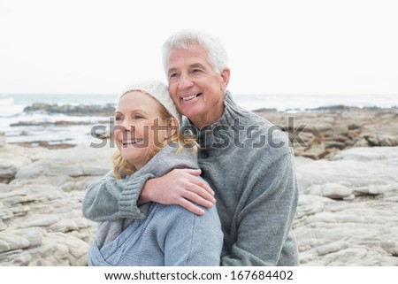 Close-up of a romantic senior couple together on a rocky beach