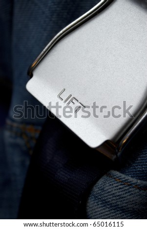 """Close-up of a safety belt with highlight a word """"LIFT"""" - stock photo"""