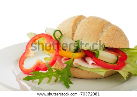 Close-up of a sandwich with ham and vegetables - stock photo