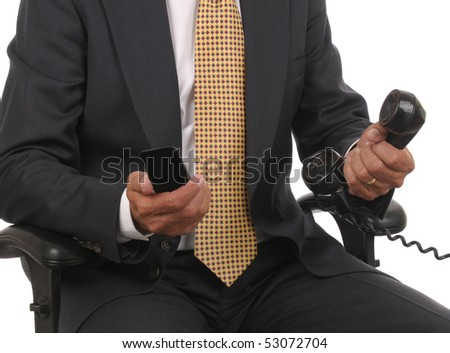 Close up of a seated businessman holding a cell phone and a line line in horizontal format over white background. Man is only showing from his shoulders to his lap. - stock photo