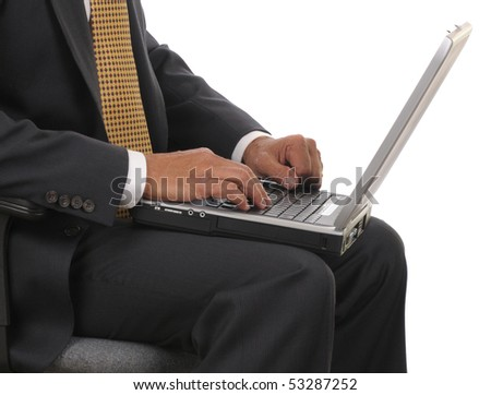 Close up of a seated businessman holding his Laptop Computer in horizontal format over white background. Man is only showing from his shoulders to his lap. - stock photo