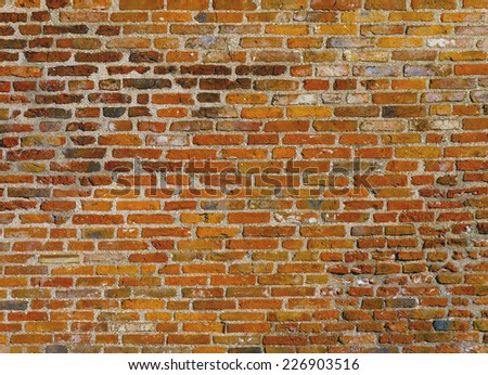 Close up of a section of brick wall on house - stock photo