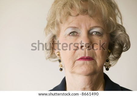Close-up of a senior woman looking directly at the camera. - stock photo