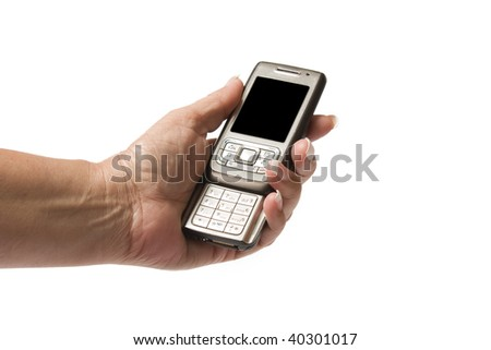 Close up of a senior woman's hand holding a cellphone, isolated on a white background. - stock photo