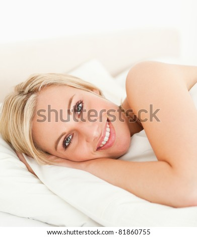 Close up of a serene woman opening her eyes in her bedroom